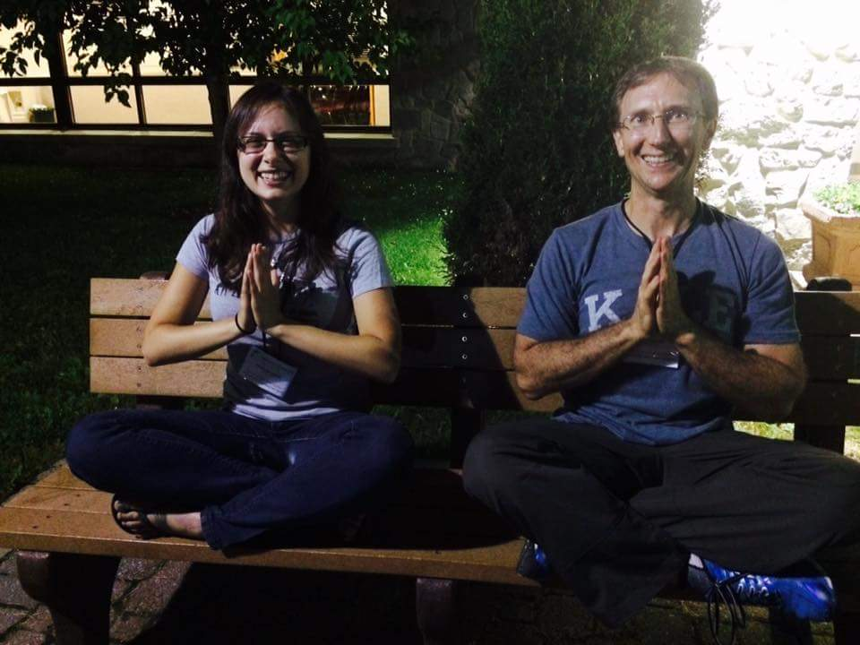 LWH Founder JP sitting with assistant Mariam showing namaste hands