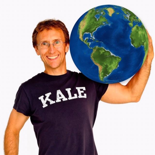 LWH co-founder, JP, facing front; wearing a black t-shirt that reads KALE and cradling the earth on his left shoulder