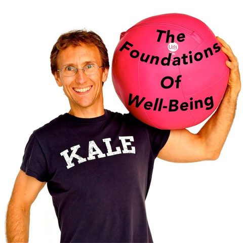 "JP in KALE shirt holding ""Foundations of Well-Being"" ball"
