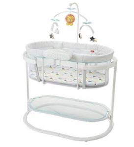 White baby bassinet with animal mobile